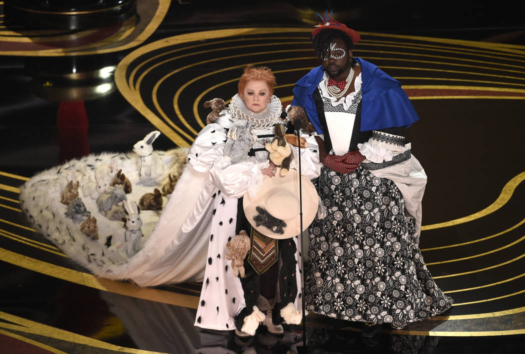 Melissa McCarthy, left, and Brian Tyree Henry present the award for best costume design at the Oscars on Sunday, Feb. 24, 2019, at the Dolby Theatre in Los Angeles. (Photo by Chris Pizzello/Invisi ...