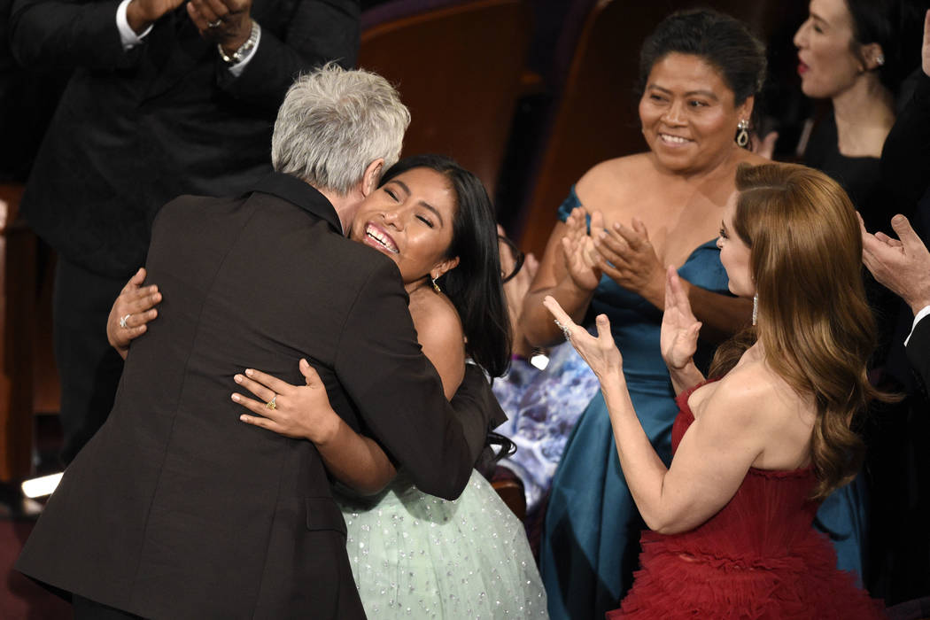 Alfonso Cuaron, left, is congratulated by Yalitza Aparicio, from second left, Margarita Martinez Merino and Marina de Tavirar, as he is announced the winner for best foreign language film for &quo ...