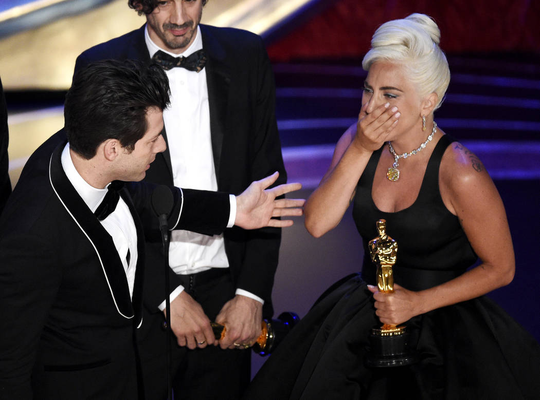 "Mark Ronson, from left, Anthony Rossomando and Lady Gaga accept the award for best original song for ""Shallow"" from ""A Star Is Born"" at the Oscars on Sunday, Feb. 24, 2019, at ..."