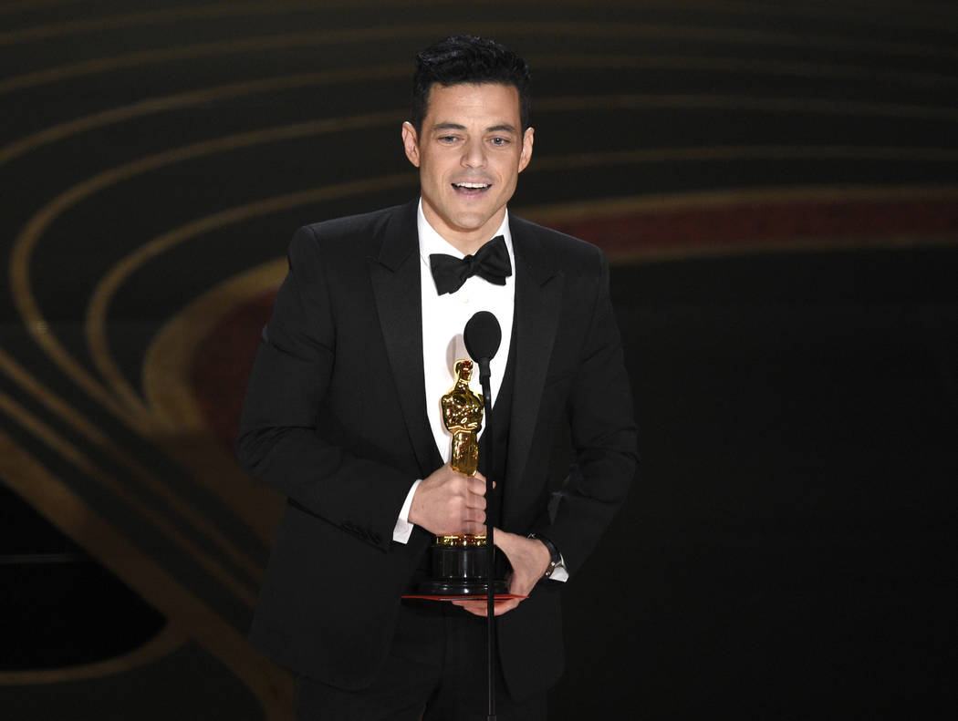 "Rami Malek accepts the award for best performance by an actor in a leading role for ""Bohemian Rhapsody"" at the Oscars on Sunday, Feb. 24, 2019, at the Dolby Theatre in Los Angeles. (Phot ..."