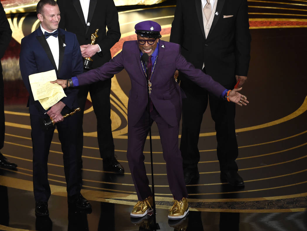 "Charlie Wachtel, left, and Spike Lee accept the award for best adapted screenplay for ""BlacKkKlansman"" at the Oscars on Sunday, Feb. 24, 2019, at the Dolby Theatre in Los Angeles. (Photo ..."