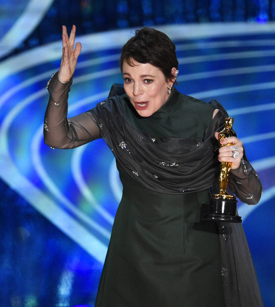 "Olivia Colman reacts as she accepts the award for best performance by an actress in a leading role for ""The Favourite"" at the Oscars on Sunday, Feb. 24, 2019, at the Dolby Theatre in Los ..."