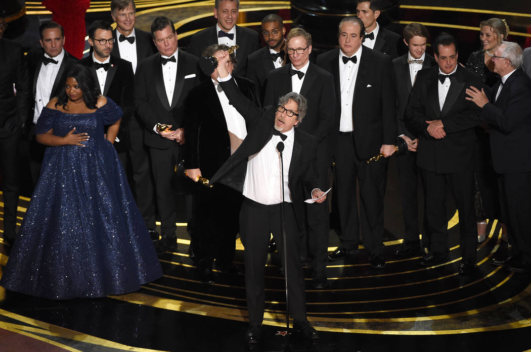 "Peter Farrelly, center, and the cast and crew of ""Green Book"" accept the award for best picture at the Oscars on Sunday, Feb. 24, 2019, at the Dolby Theatre in Los Angeles. (Photo by Chr ..."
