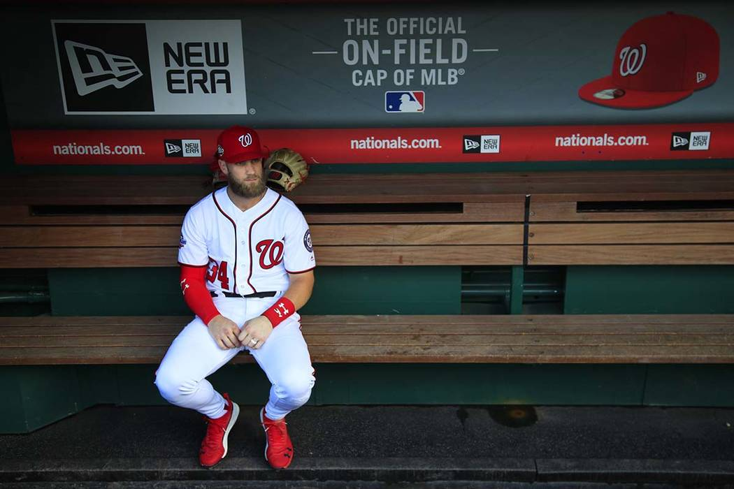 Washington Nationals Bryce Harper, looks out from the dugout on Wednesday, Sept. 26, 2018. Harper met with Los Angeles Dodgers officials in Las Vegas on Sunday, Feb. 24, 2019. (AP Photo/Manuel Bal ...
