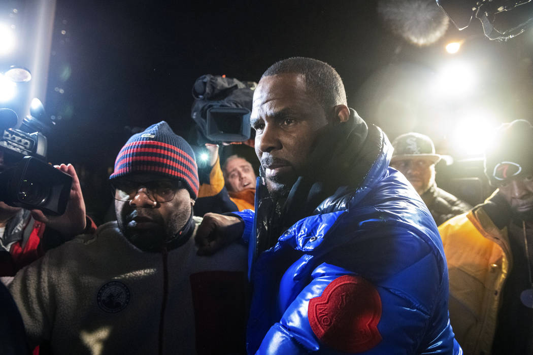 R. Kelly surrenders to authorities at Chicago First District police station, Friday, Feb. 22, 2019. The R&B star was taken into custody hours after authorities announced multiple charges of aggrav ...