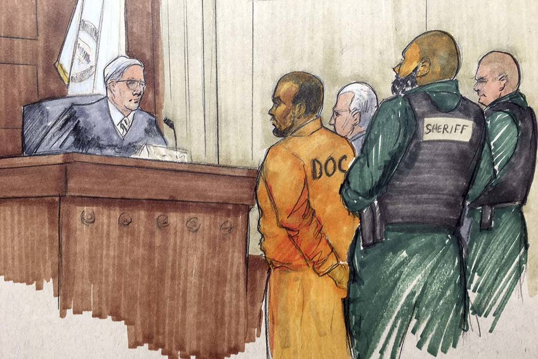 In this courtroom sketch, R&B singer R. Kelly appears before Cook County Associate Judge Lawrence Flood with his attorney Steve Greenberg Monday, Feb. 25, 2019, at the Leighton Criminal Courth ...
