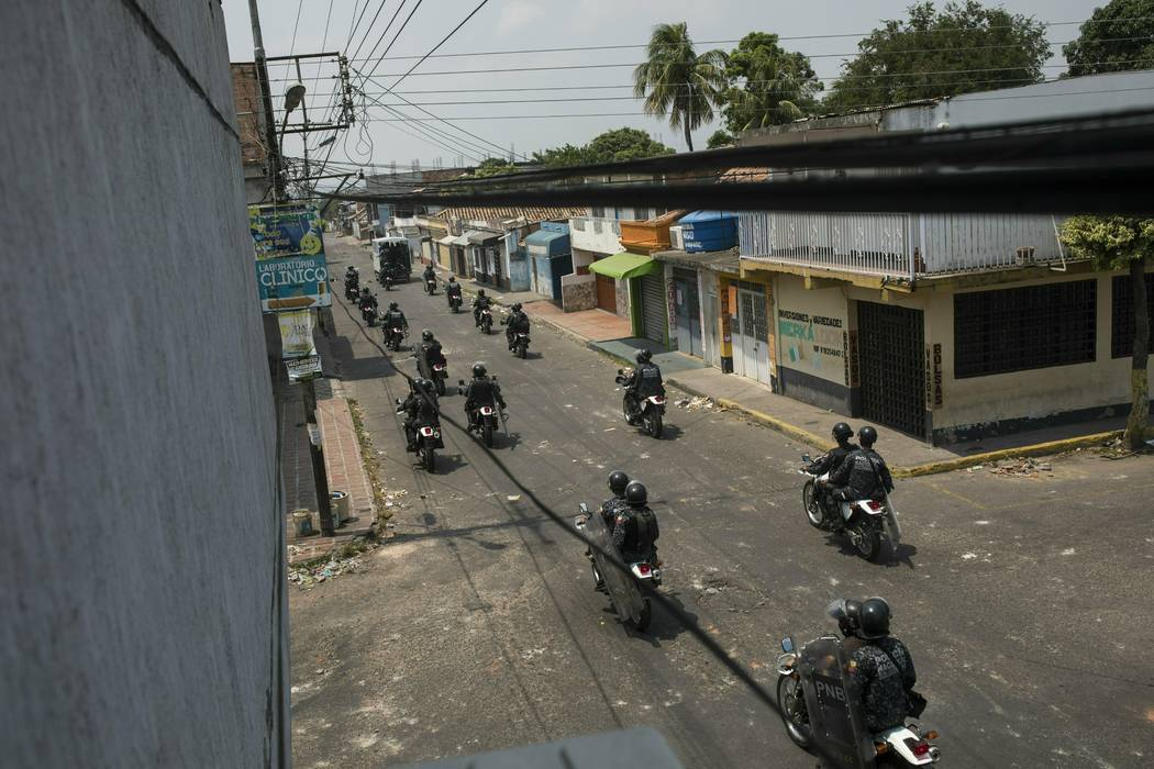 Bolivarian National Police patrol on motorcycles through Urena, Venezuela, near the border with Colombia, Sunday, Feb. 24, 2019. Venezuelan President Maduro is blocking the U.S.-backed aid that is ...