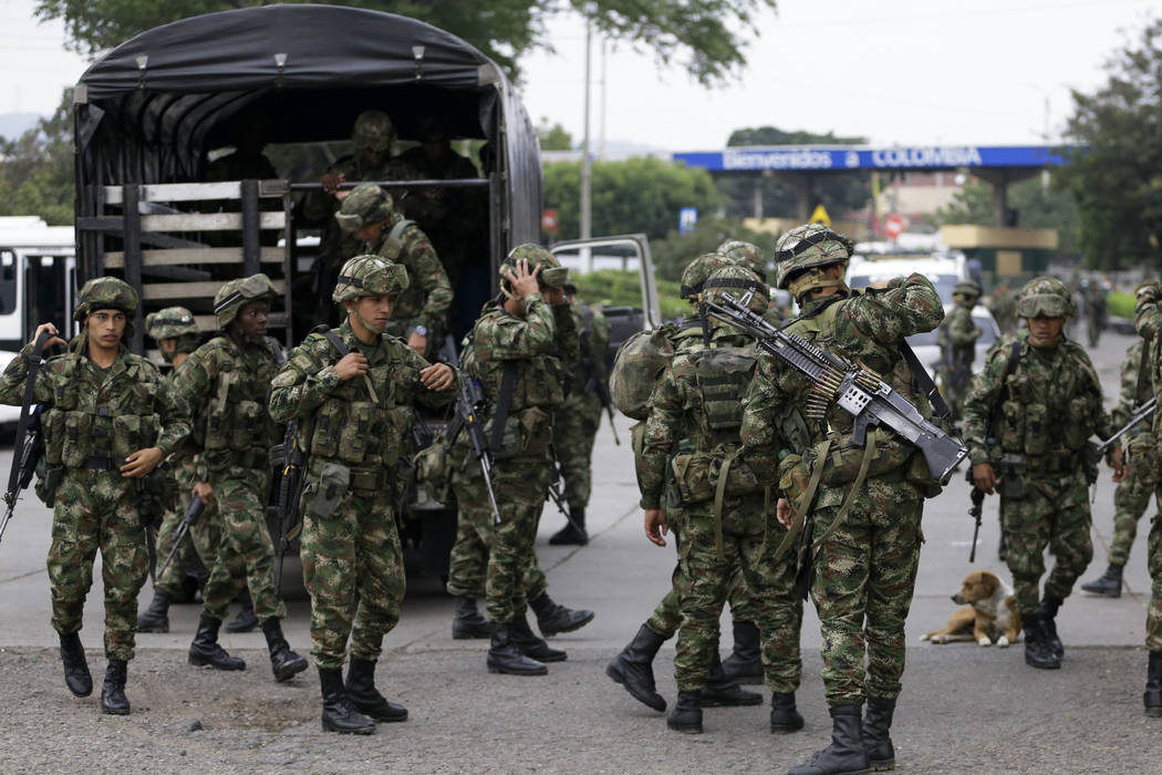 Colombian soldiers arrive to the Simon Bolivar International Bridge in La Parada, near Cucuta, Colombia, on the border with Venezuela, early Sunday, Feb. 24, 2019. Opponents of President Nicolas M ...