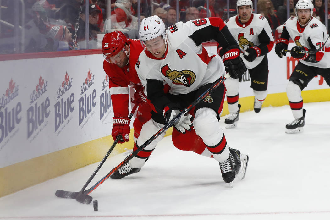 Ottawa Senators right wing Mark Stone (61) battles with Detroit Red Wings left wing Thomas Vanek (26) for the puck in the second period of an NHL hockey game Friday, Dec. 14, 2018, in Detroit. (AP ...