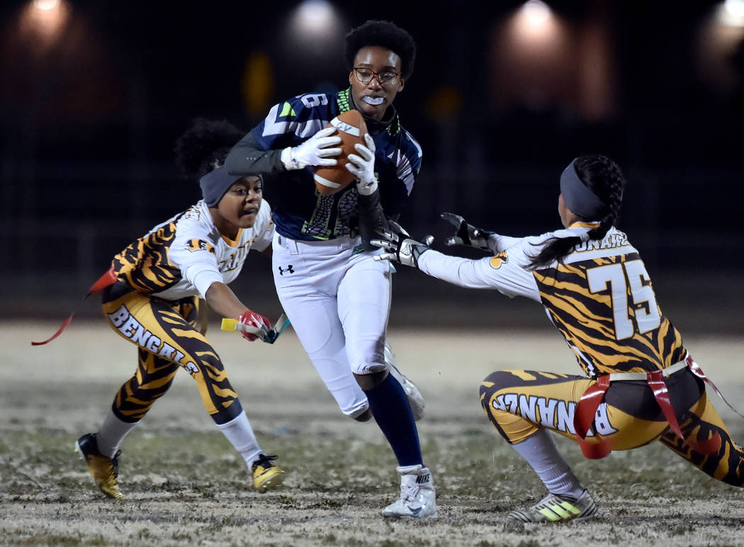 Green Valley's Deborah Grant (16) carries the ball against Bonanza during Class 4A state flag football championship game at Cimarron High School Monday, Feb. 25, 2019, in Las Vegas. Green Valley w ...