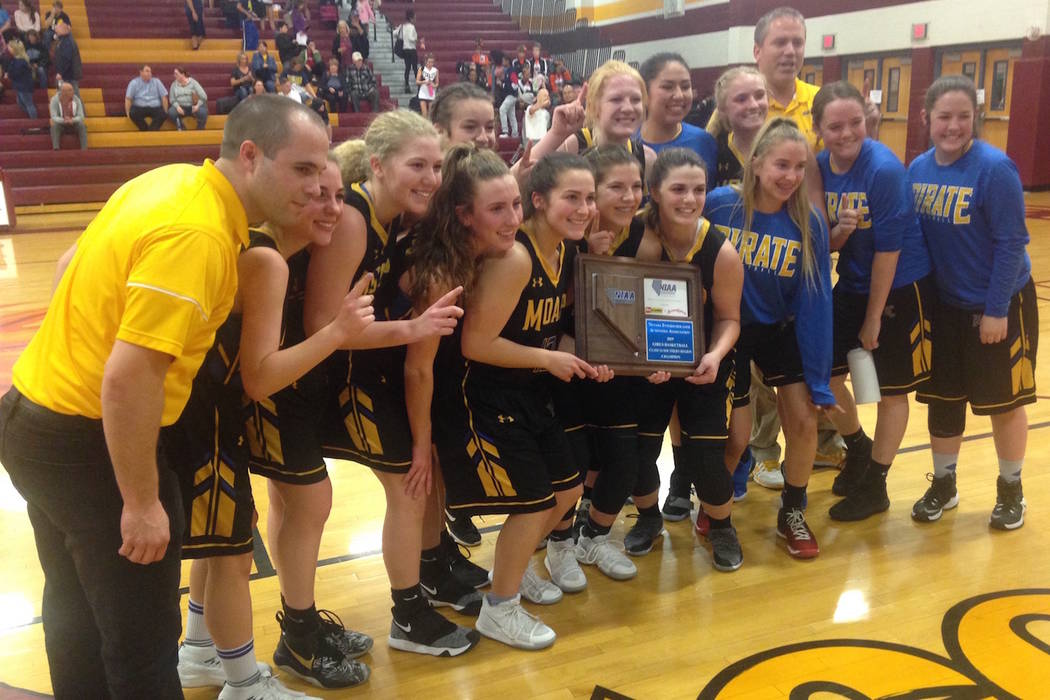 Moapa Valley's girls pose with the Class 3A Southern Region championship trophy after defeating Boulder City, 50-44 on Monday, Feb. 25, 2019 at Del Sol. (Bartt Davis/Las Vegas Review-Journal)