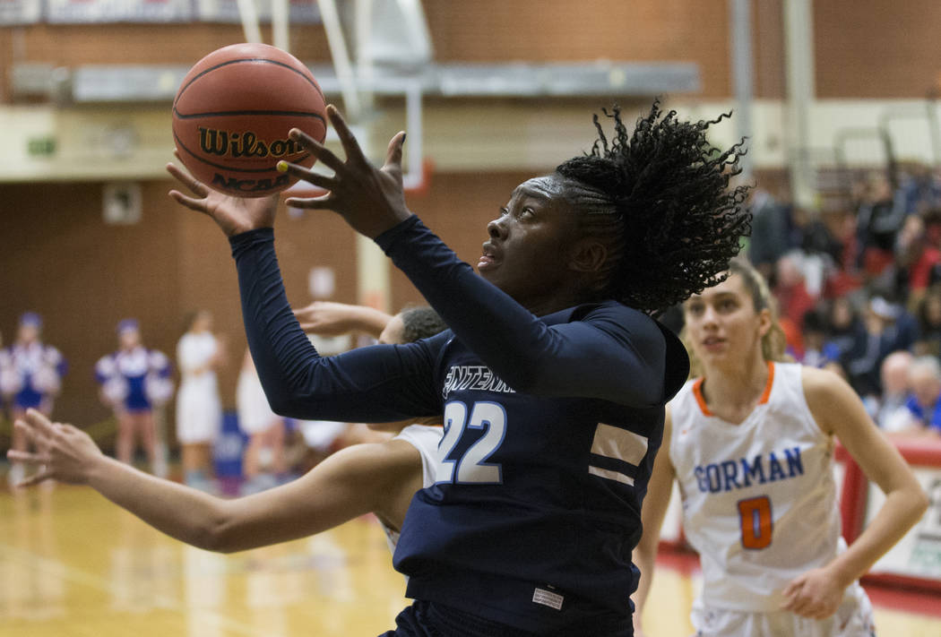 Centennial senior Eboni Walker (22) drives baseline past Bishop Gorman sophomore Izzy Westbrook (0) in the fourth quarter during the Southern Nevada girls basketball championship game on Monday, F ...