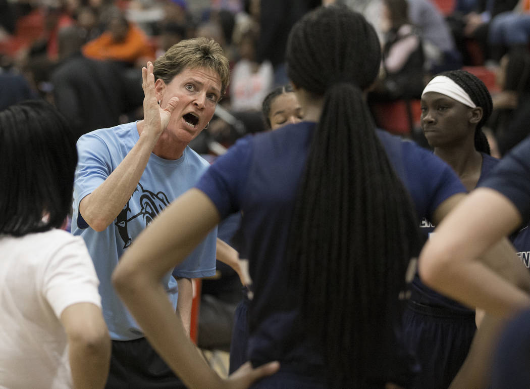 Centennial head coach Karen Weitz tries to fire up her team in the second quarter during a time out during the Bulldogs game with Bishop Gorman during the Southern Nevada girls basketball champion ...