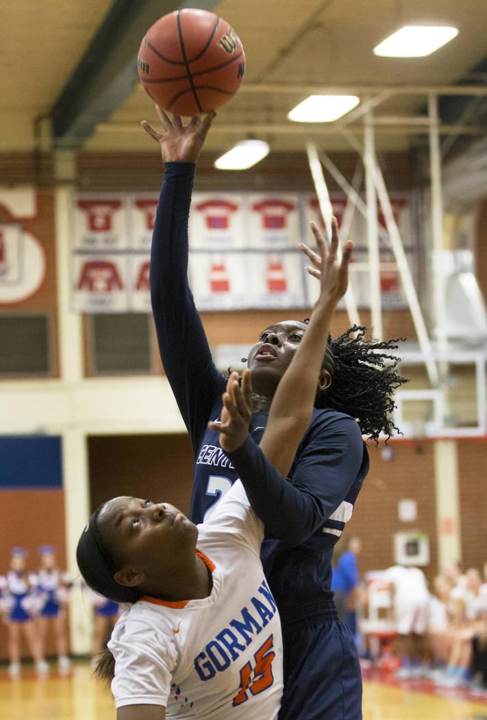 Centennial senior Eboni Walker (22) shoots a jump shot over Bishop Gorman freshman Asya Bey (15) in the fourth quarter during the Southern Nevada girls basketball championship game on Monday, Feb. ...