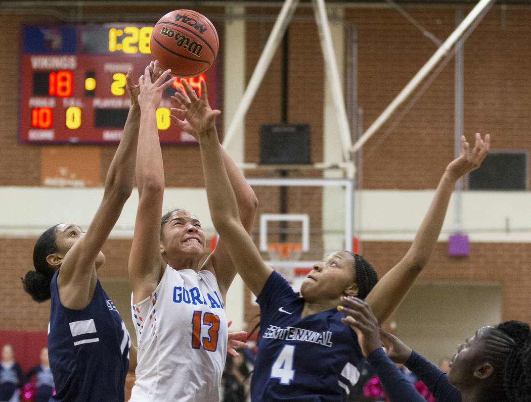 Bishop Gorman senior Georgia Ohiaeri (13) fights for a rebound with Centennial sophomore Taylor Bigby (4) in the second quarter during the Southern Nevada girls basketball championship game on Mon ...