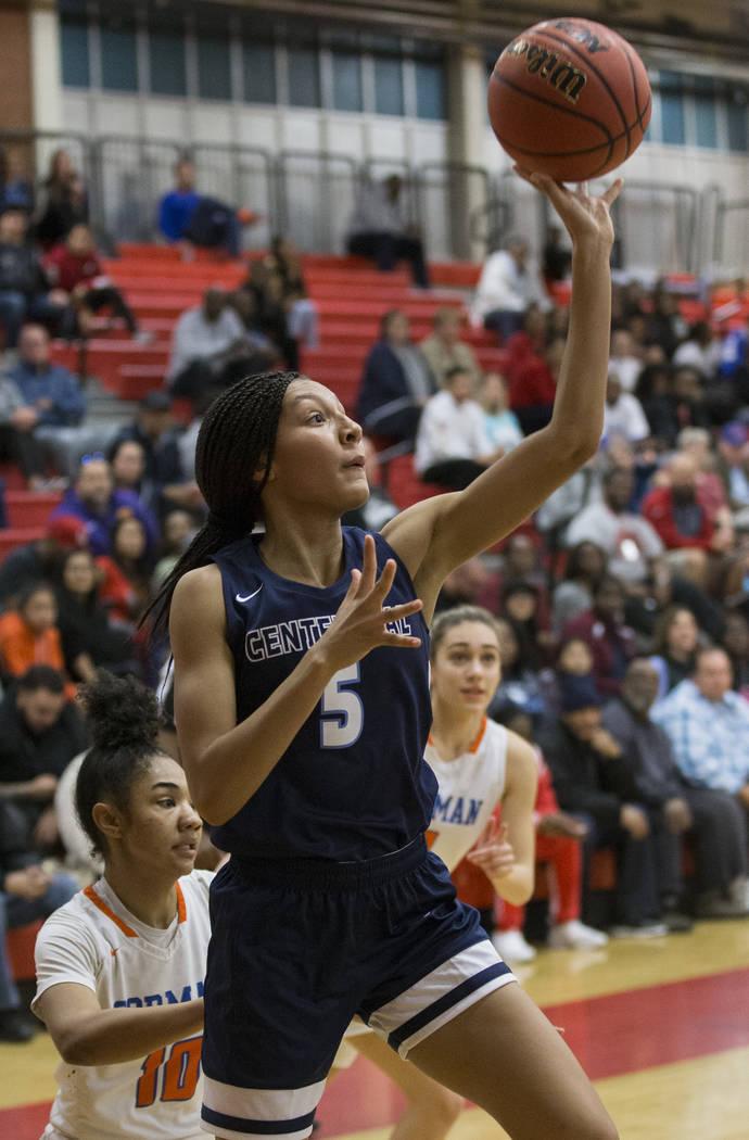 Centennial junior Jade Thomas (5) shoots a baseline runner past Bishop Gorman senior Maleah Turner (10) in the second quarter during the Southern Nevada girls basketball championship game on Monda ...