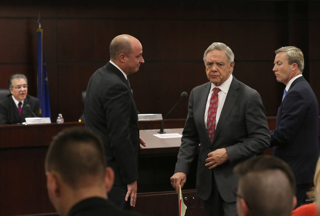 Dr. Tony Alamo, left, chairman of the Nevada Gaming Commission, watches as Matt Maddox, CEO of Wynn Resorts Ltd., second left, and Phil Satre, front right, board chairman of Wynn Resorts Ltd., ret ...