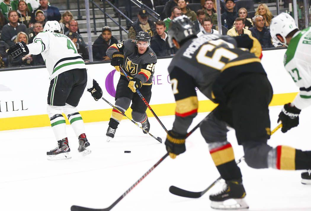 Golden Knights center Paul Stastny (26) passes the puck to left wing Max Pacioretty (67) during the first period of an NHL hockey game against the Dallas Stars at T-Mobile Arena in Las Vegas on Tu ...