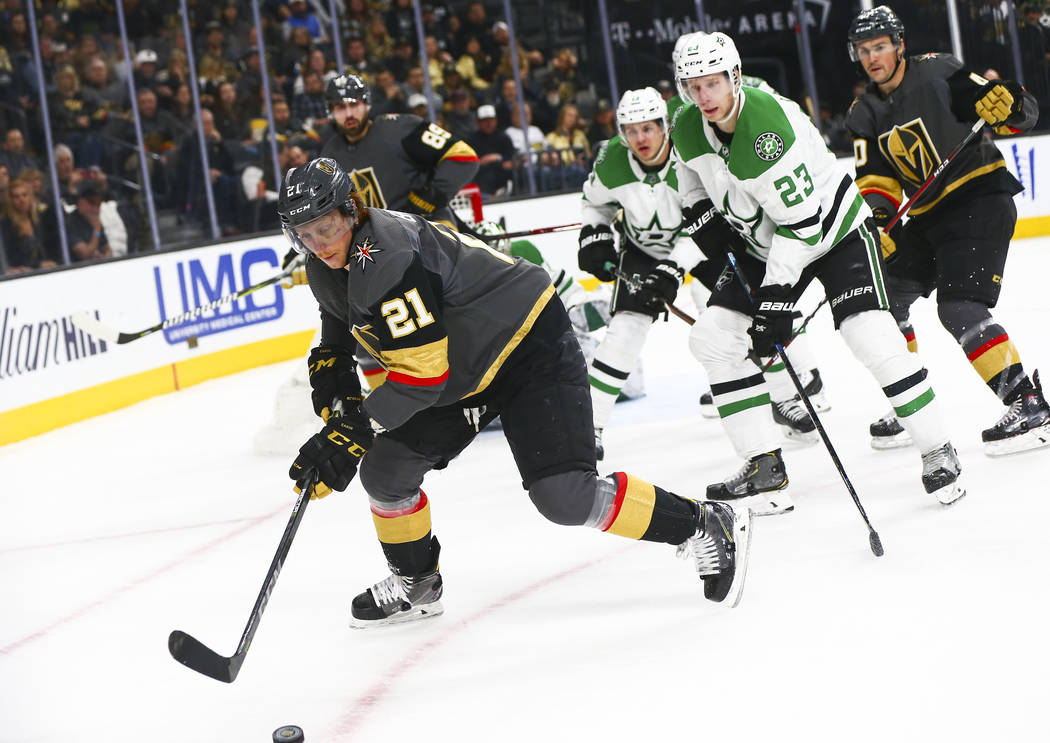 Golden Knights center Cody Eakin (21) moves the puck in front of Dallas Stars defenseman Esa Lindell (23) during the first period of an NHL hockey game at T-Mobile Arena in Las Vegas on Tuesday, F ...