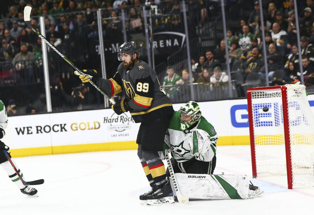 Golden Knights left wing Max Pacioretty, not pictured, scores past Dallas Stars goaltender Ben Bishop (30) while Golden Knights right wing Alex Tuch (89) looks on during the second period of an NH ...