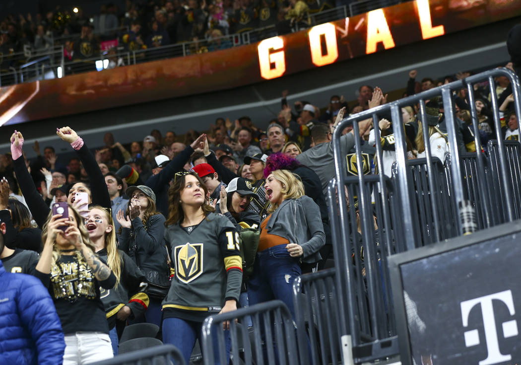 Golden Knights fans celebrate a goal by Golden Knights left wing Max Pacioretty, not pictured, during the second period of an NHL hockey game against the Dallas Stars at T-Mobile Arena in Las Vega ...