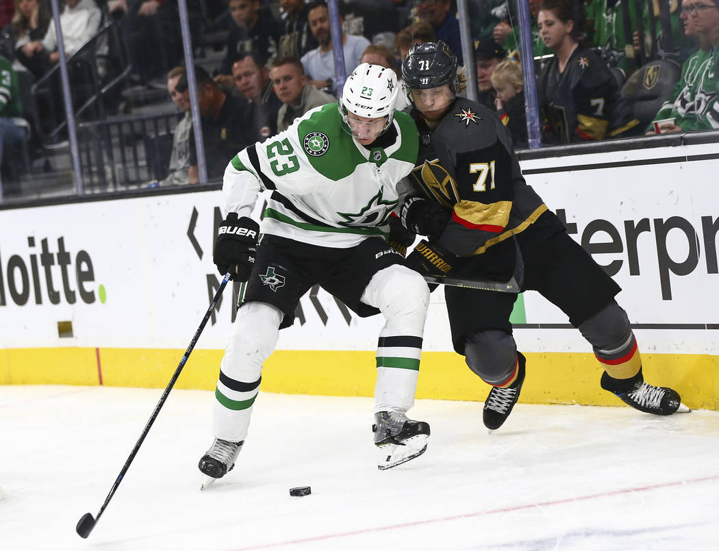 Golden Knights center William Karlsson (71) battles for the puck against Dallas Stars defenseman Esa Lindell (23) during the second period of an NHL hockey game at T-Mobile Arena in Las Vegas on T ...