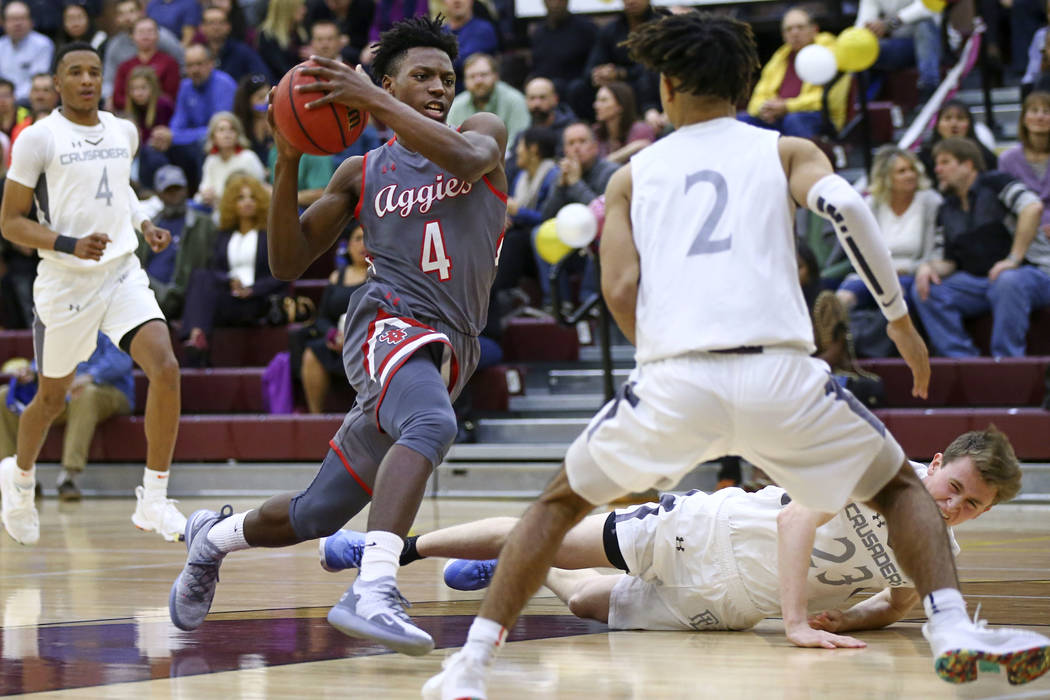 Arbor View's Tyre Williams (4) drives the ball against Faith Lutheran's Donavan Jackson (2) during the first half of a basketball game at Faith Lutheran High School in Las Vegas on Thursday, Jan. ...