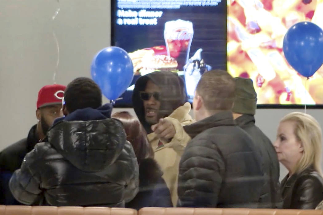 In this image made from a video, R. Kelly stops at a McDonald's restaurant in Chicago Monday, Feb. 25, 2019, after a suburban Chicago woman posted the $100,000 bail for him to be freed from jail w ...