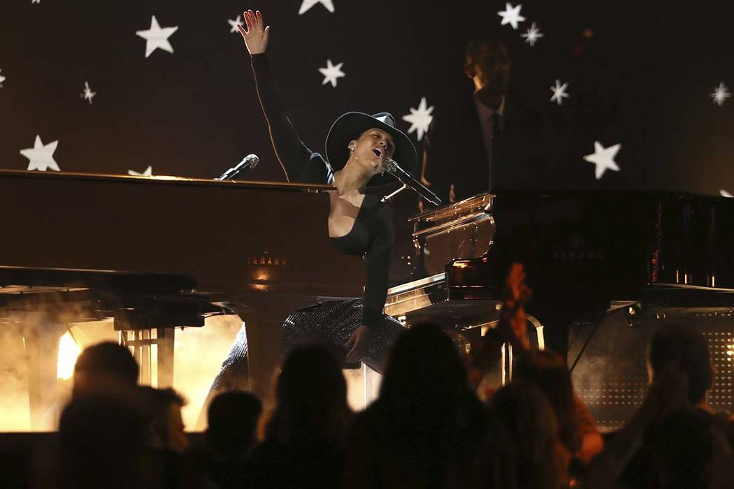 Host Alicia Keys performs a medley at the 61st annual Grammy Awards on Sunday, Feb. 10, 2019, in Los Angeles. (Matt Sayles/Invision/AP)