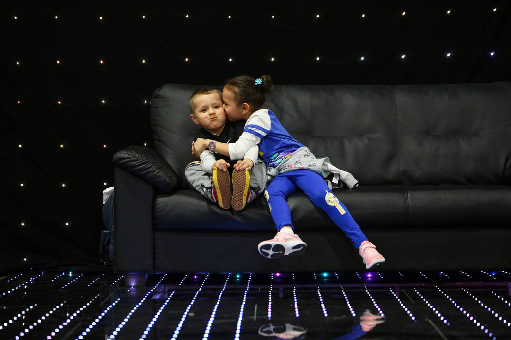 Ava Gamboa, 6, kisses her brother Jose Gamboa, 4, on the cheek at the at the Photo Booth Expo at the South Point Hotel and Casino in Las Vegas, Tuesday, Feb. 26, 2019. (Caroline Brehman/Las Vegas ...