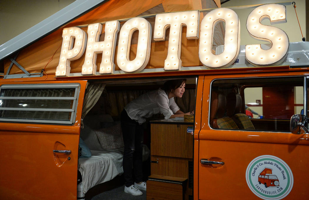 Page Lee stands up to take a photo in the Charlie & Co. Photo Booth at the Simple Booth stand at the Photo Booth Expo at the South Point Hotel and Casino in Las Vegas, Tuesday, Feb. 26, 2019. ...
