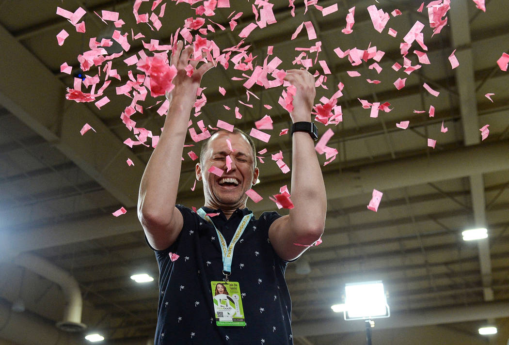 Brad Dixon throws up confetti as he gets his photo taken at the at theSlowGo 360 stand at the Photo Booth Expo at the South Point Hotel and Casino in Las Vegas, Tuesday, Feb. 26, 2019. (Caroline B ...