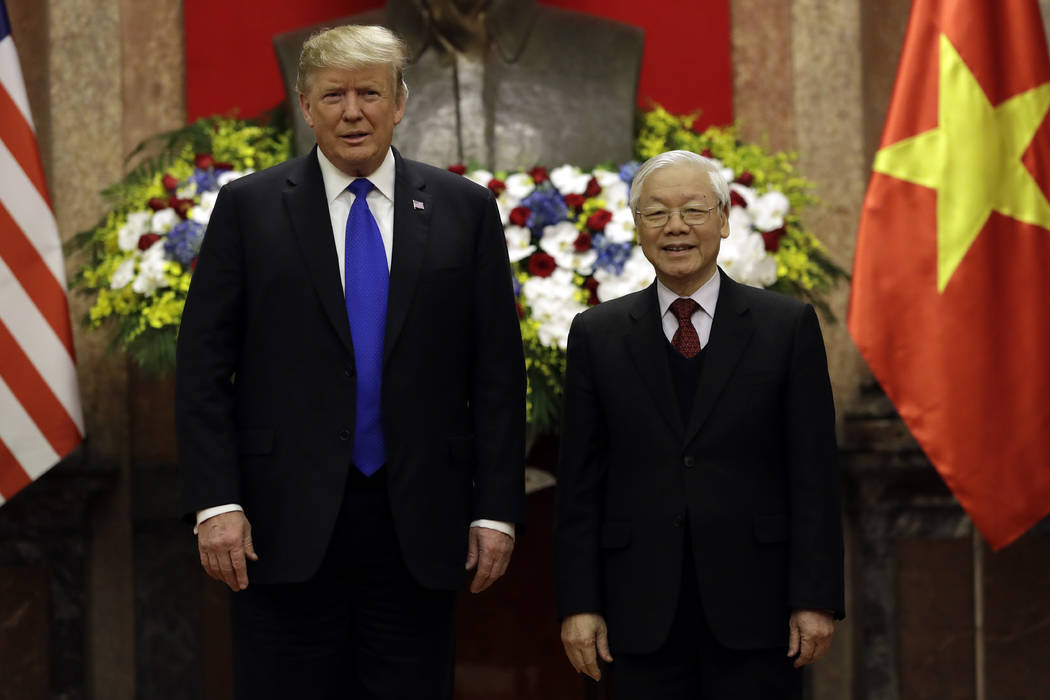 President Donald Trump meets Vietnamese President Nguyen Phu Trong at the Presidential Palace, Wednesday, Feb. 27, 2019, in Hanoi. (AP Photo/Evan Vucci)