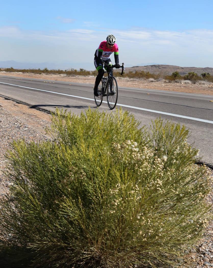 A cyclist rides his bike near Red Rock Canyon on Wednesday, Feb. 27, 2019, in Las Vegas. Bizuayehu Tesfaye Las Vegas Review-Journal @bizutesfaye