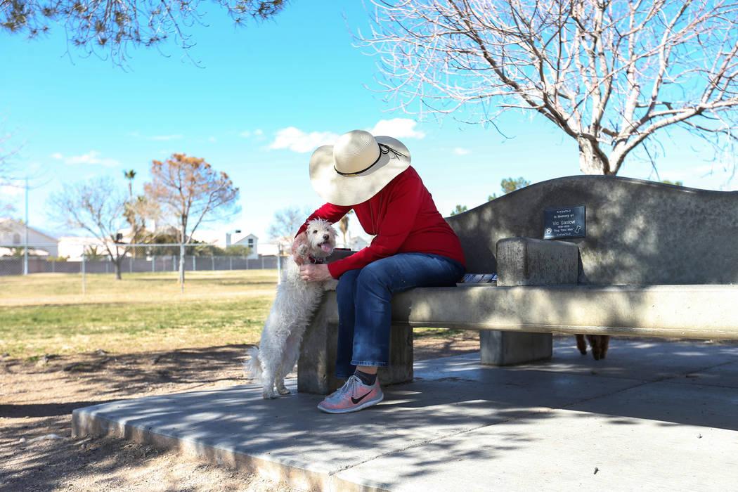 Rimsen Doe picks up her dog, Kiki, at Woofter Family Park in Las Vegas, Wednesday, Feb. 27, 2019. (Caroline Brehman/Las Vegas Review-Journal) @carolinebrehman