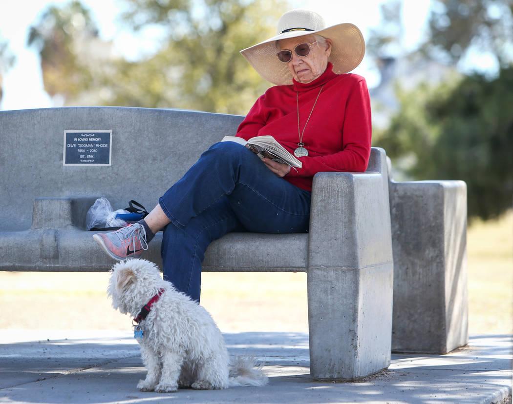 Rimsen Doe reads a book while sitting next to her dog, Kiki, at Woofter Family Park in Las Vegas, Wednesday, Feb. 27, 2019. (Caroline Brehman/Las Vegas Review-Journal) @carolinebrehman