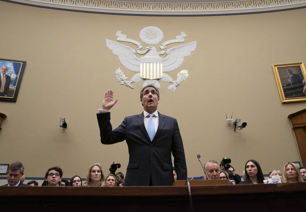 Michael Cohen, President Donald Trump's former personal lawyer, is sworn in to testify before the House Oversight and Reform Committee on Capitol Hill in Washington, Wednesday, Feb. 27, 2019. (AP ...