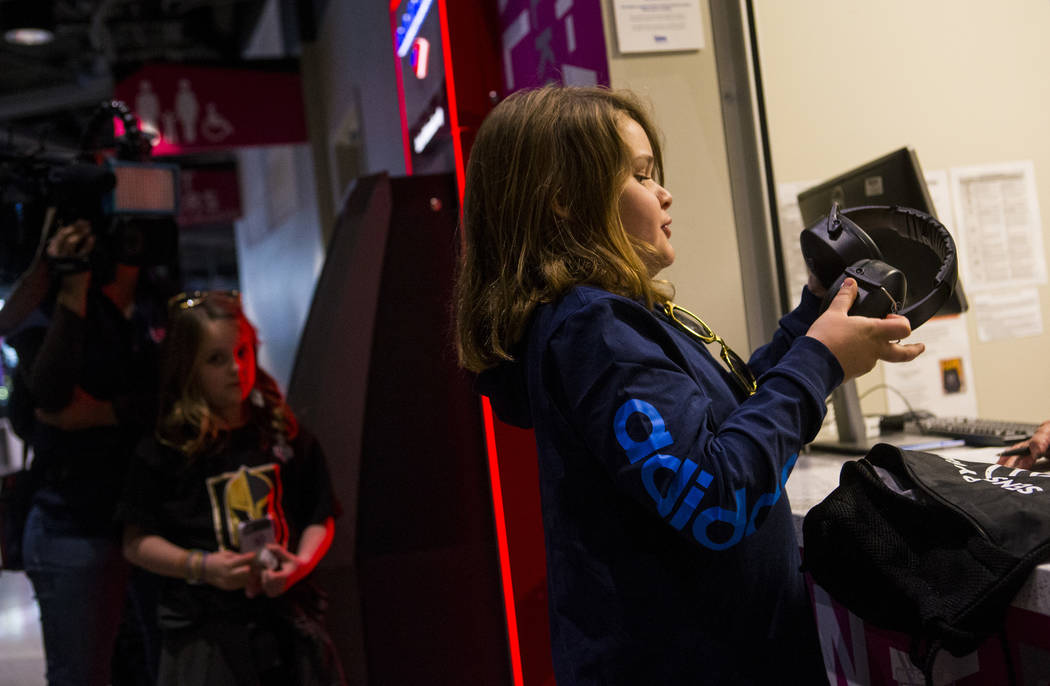 Christian Mouer, 11, holds up noise-cancelling headphones after picking up a sensory bag at before a Golden Knights game at T-Mobile Arena in Las Vegas on Tuesday, Feb. 26, 2019. The sensory bag f ...