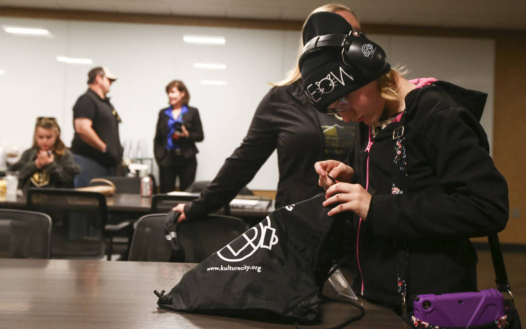 Kristlynn Allison, 11, looks through her sensory bag before a Golden Knights game at T-Mobile Arena in Las Vegas on Tuesday, Feb. 26, 2019. The sensory bag features noise-cancelling headphones, fi ...