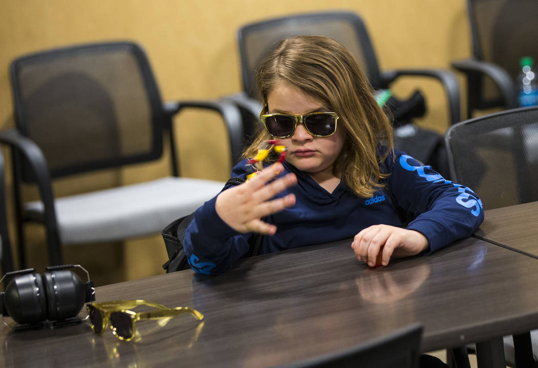 Christian Mouer, 11, plays with a fidget toy from a sensory bag before a Golden Knights game at T-Mobile Arena in Las Vegas on Tuesday, Feb. 26, 2019. The sensory bag features noise-cancelling hea ...
