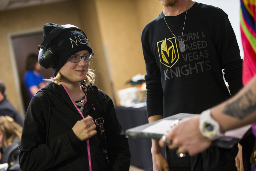 Kristlynn Allison, 11, talks with Daniel Platzman of Imagine Dragons before a hockey game at T-Mobile Arena in Las Vegas on Tuesday, Feb. 26, 2019. (Chase Stevens/Las Vegas Review-Journal) @csstev ...