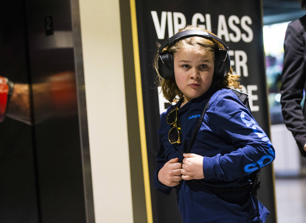 Christian Mouer, 11, walks around the arena with noise-cancelling headphones that he picked up with a sensory bag before a Golden Knights game at T-Mobile Arena in Las Vegas on Tuesday, Feb. 26, 2 ...