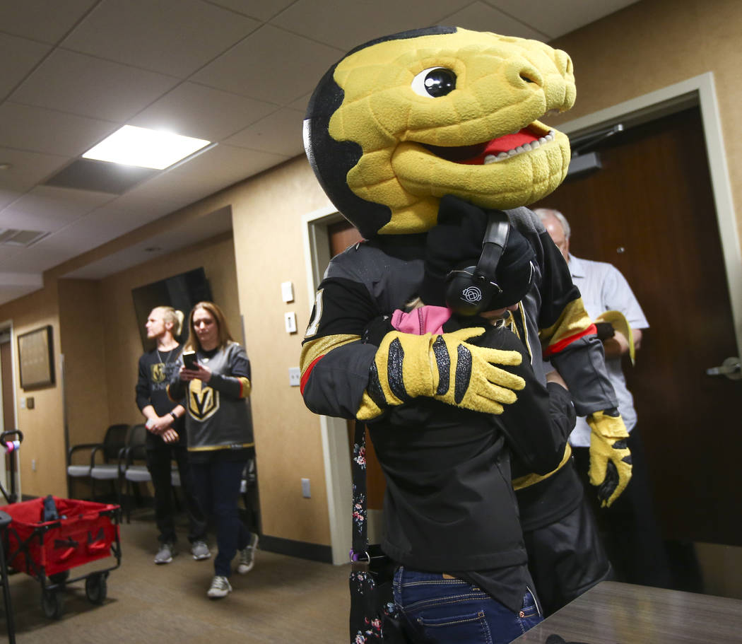 Kristlynn Allison, 11, gets a hug from Golden Knights mascot Chance before a hockey game at T-Mobile Arena in Las Vegas on Tuesday, Feb. 26, 2019. (Chase Stevens/Las Vegas Review-Journal) @cssteve ...