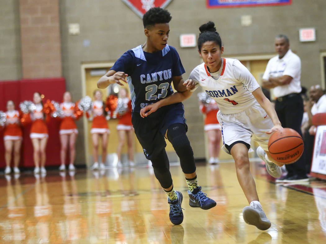 Bishop Gorman's Caira Young (1) drives the ball against Canyon Springs' Kayla Johnson (23) during the first half of a Class 4A state girls basketball quarterfinal game at Arbor View High School in ...
