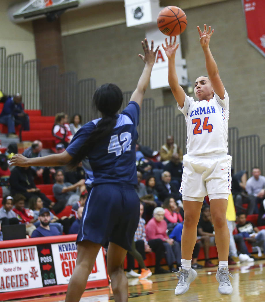 Bishop Gorman's Bentleigh Hoskins (24) shoots over Canyon Springs' Brooklyn Knox (42) during the first half of a Class 4A state girls basketball quarterfinal game at Arbor View High School in Las ...
