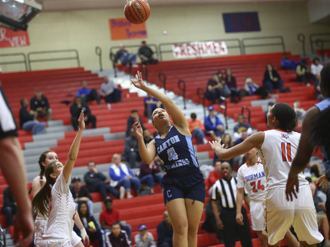 Canyon Springs' Jhane Richardson (4) shoots over Bishop Gorman's Olivia Smith (11) during the second half of a Class 4A state girls basketball quarterfinal game at Arbor View High School in Las Ve ...