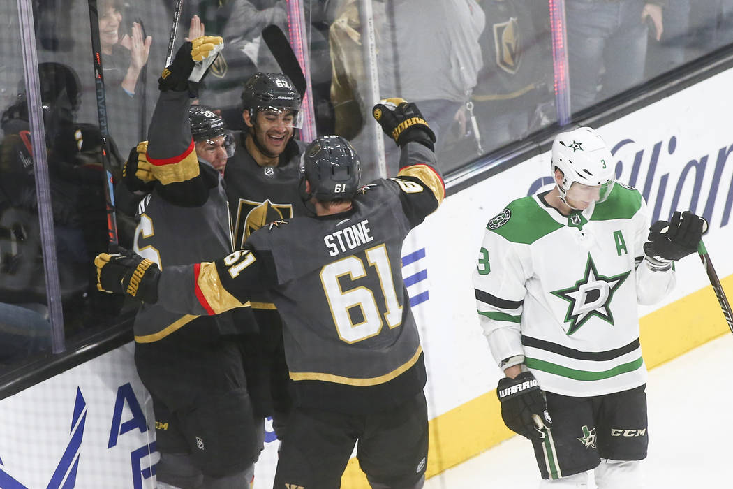 Golden Knights left wing Max Pacioretty, second from left, celebrates his goal with center Paul Stastny, left, and right wing Mark Stone (61) as Dallas Stars defenseman John Klingberg (3) reacts d ...