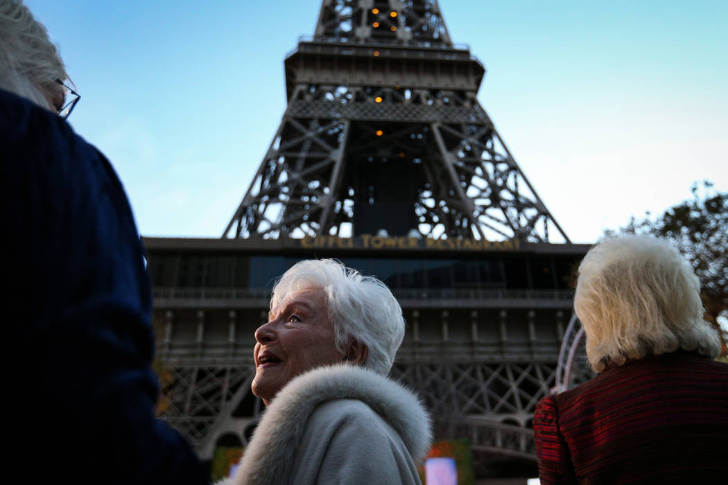 French singer and actress Line Renaud talks with attendees before the Paris Las Vegas debuts a new $1.7 million Eiffel Tower light show on the Strip in Las Vegas, Wednesday, Feb. 27, 2019. (Caroli ...