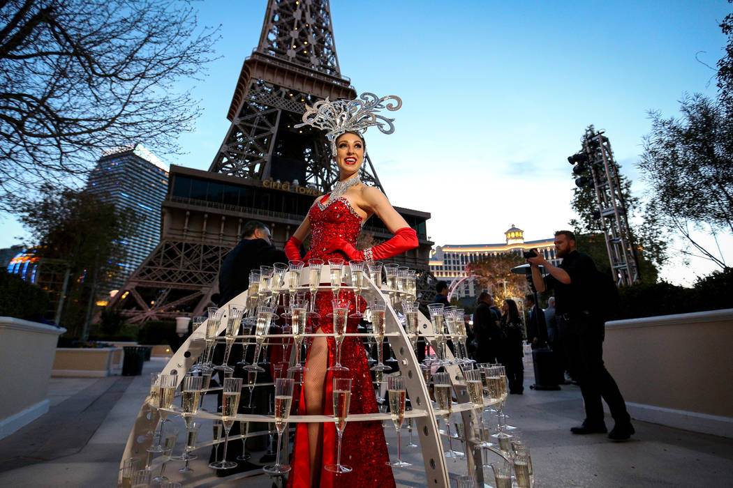 Alexandra Remke poses in a champagne dress structure at the Paris Las Vegas as it debuts a new $1.7 million Eiffel Tower light show on the Strip in Las Vegas, Wednesday, Feb. 27, 2019. (Caroline B ...