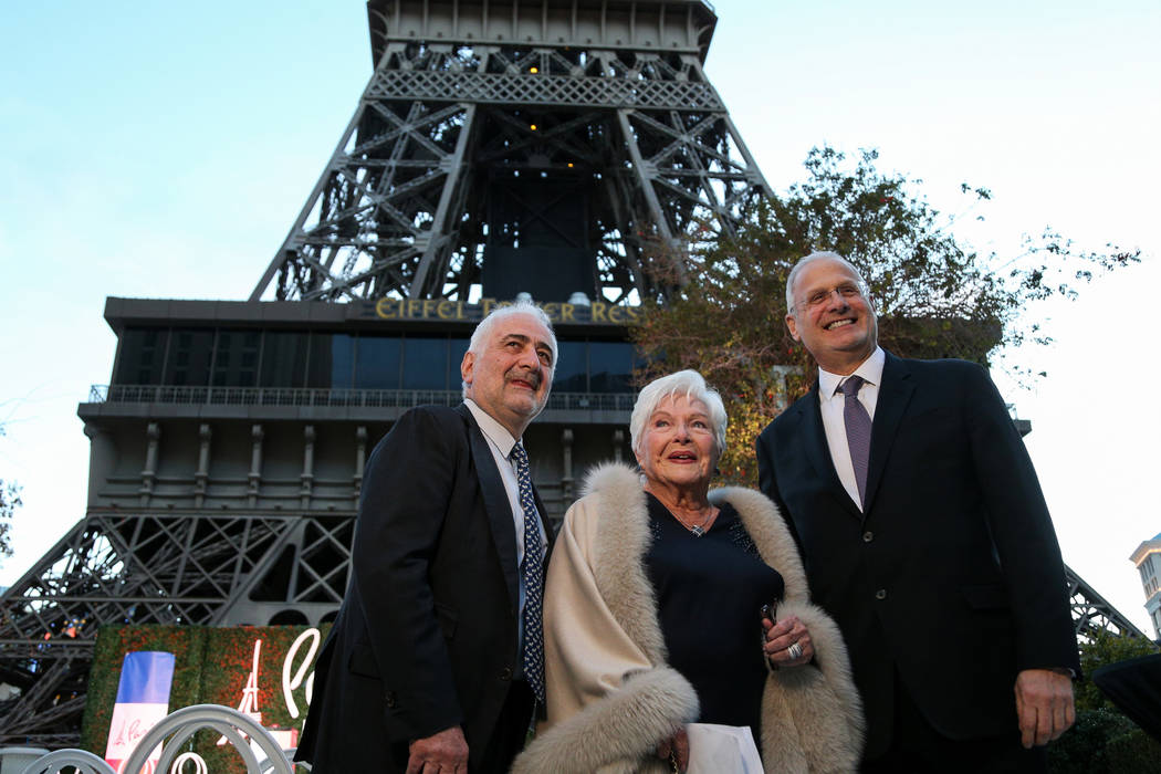 Michelin-starred chef Guy Savoy, French singer and actress Line Renaud and Caesars Corporation President Gary Selesner gather at the Paris Las Vegas as it debuts a new $1.7 million Eiffel Tower li ...